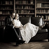 Formal portrait of a bride and groom in the master Library at Dulwich College
