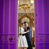 Funky portrait of a bride and groom standing within the big doors at Nonsuch Mansion