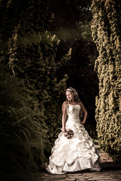 Atmospheric portrait of the bride on her wedding day in the grounds of The Grange