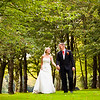 Natural portrait of a bride and groom walking in Kingswood Golf Club