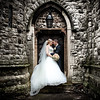 Formal portrait of a bride and groom at St Dunstan's Church in Cheam