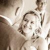 Bride looks lovingly at her husband during their wedding service