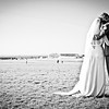 Bride and groom standing overlooking Epsom Downs Race Course