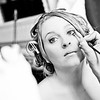 Bride having makeup applied whilst getting ready for her wedding day