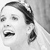 Bride's reaction during the speeches at her wedding at Pangdean farm in West Sussex