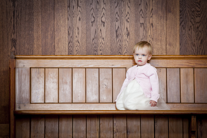 Small Bridesmaid sitting on a pew in the Church
