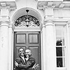 Groom and his close friend embrace outside Morden Registry Office