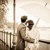 Bride and groom overlook the Thames at Putney under an umbrella