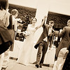 Groom lifts his wife's arm aloft  after being declared husband and wife