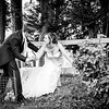 Groom assists his bride through a wooden fence at The Crown Inn