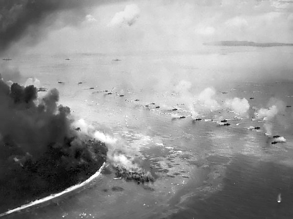 September 1944: The first wave of LVTs approaching Orange beach for invasion. The Landing Vehicle Tracked (LVT) a small amphibious warfare landing craft. Originally intended solely as cargo carriers for ship to shore operations, they rapidly evolved into assault troop and fire support vehicles.