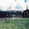 Cumbres Pass summit with depot building and C&T train (8/5/1990).