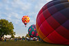 36th Annual Huff 'n Puff Balloon Rally 2 of 4<br /> Morning launch and evening glow/tether at 2011 Huff 'n Puff Hot Air Balloon Rally in Topeka, Kan.<br /> Rick McPherson<br /> <br /> Honorable Mention - Photojournalism