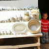 Boy in a Pottery Store