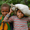 Boy with Sack on His Head