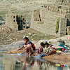Gypsy Mother & Children Washing Clothes