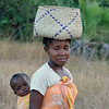 Woman with Baby & Straw Basket