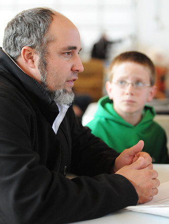 Globe/T. Rob Brown<br /> Faces of Recovery: Leland Hostetler, project coordinator with the Joplin Response for Mennonite Disaster Service, speaks as Bradley Garber, 11, looks on.