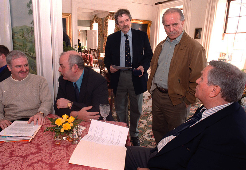 Paul Sheehy, right, greets Irish visitors at an event at Nesmith House in 2000, from left, Gerry Henry, Johnny McCarroll, Kevin Butler, and Dick Abraham from Lowell. SUN FILE PHOTO