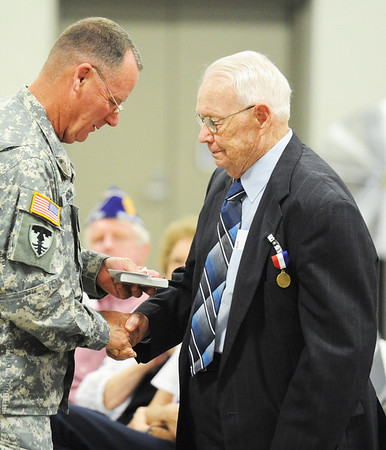 J-Mag/T. Rob Brown    Brig. Gen. J. Marty Robinson (left), assistant adjutant general--Army (support), Missouri Army National Guard, presents medals and shakes the hand of each recipient during the Patriot's Day Veterans Award Ceremony Wednesday afternoon, Sept. 11, 2013, at the Missouri National Guard Armory on 32nd Street in Joplin. The event was sponsored by the MOAA Four State Chapter in cooperation with the Guard, the Missouri Veterans Association and the state of Missouri.