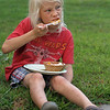 Littleton holds a Peach Social at the Historical Society as part of the town's 300th anniversary celebration. Oliver Jacobs, 7, of Littleton, eats peach dessert. (SUN/Julia Malakie)