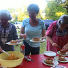 Littleton holds a Peach Social at the Historical Society as part of the town's 300th anniversary celebration. From left, Ruth Broughton of Ayer, a board member of the Littleton Historical Society, and members Ann-Marie Holland and Sandy Murray, both of Littleton, prepare servings. (SUN/Julia Malakie)