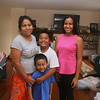[NOTE: Pin's husband Khamsan Ou didn't want to be in photo, and oldest son Edward Ou, 13, wasn't home.] Toeur Pin of Lowell, with her daughter Selena Ou, 14, and sons Brandon Ou, 10, and George Ou, 5, in their new home at 22 Astor Street. They were displaced by the Branch Street fire. (SUN/Julia Malakie)