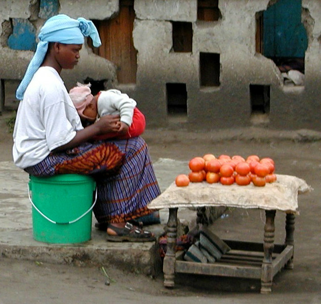 Woman & Baby Selling Tomatoes