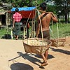 Man Carrying Baskets on His Shoulder