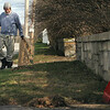 Norm Hunt of North Chelmsford rakes leftover leaves in front of his house on Middlesex Street.  (SUN/Julia Malakie)
