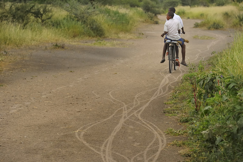 Two Boys On a Bicycle near Arusha, Tanzania, East Africa