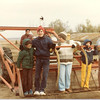 Scott, Oscar, Albert, Jeanette, Sandee, Fern with farmhand tractor on farm, 1983