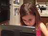 2011-12-26 1943 54 -- Kaylee engrossed by the new MacLuskie iPad