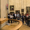 A panoramic view of the non-stop activity at the Mona Lisa.  Although flash photography is prohibited, a flash goes off every few seconds as folks struggle to control their camera.