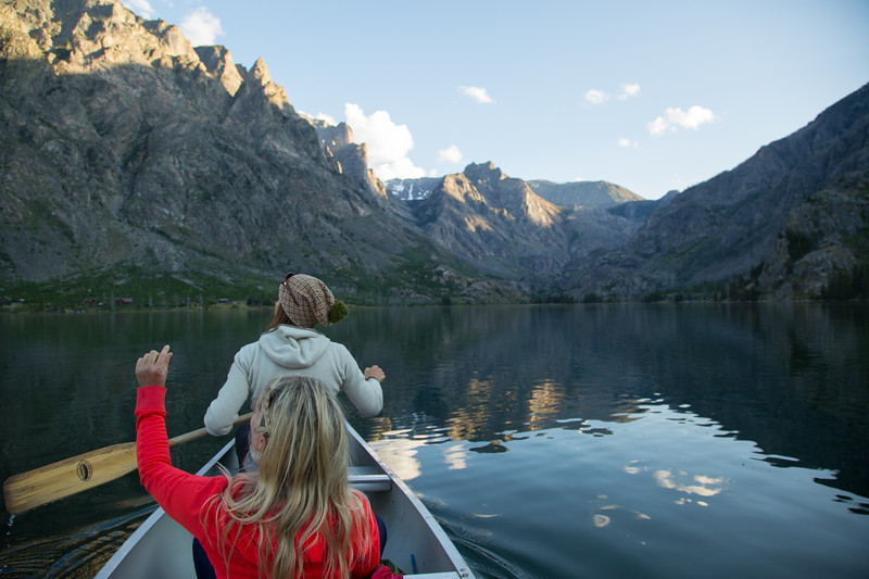 Caroline Gleich and Lydia Tanner scoping lines, soaking in the views and marinating in the Montana beauty via canoe.