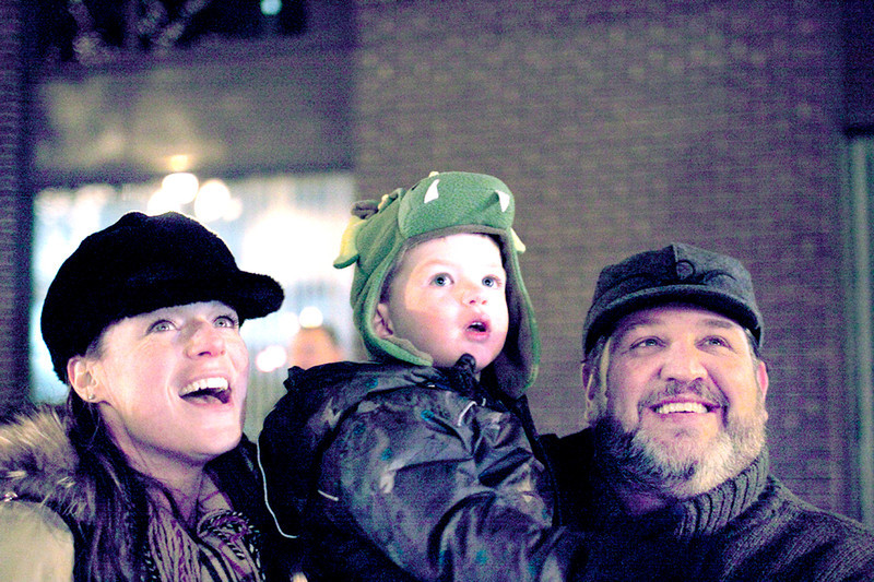 Colin McAuliffe for Suburban Life Margaret, Max, and John Barabas (L to R) watch as Santa and Mrs. Claus right by during the Wheaton Christmas Parade and tree lighting.