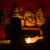Miniature statues of deities lit by candle light, Varanasi, India