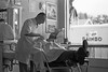 1960 CO Barber on East Colfax in Denver and Rainbow Bread truck outside