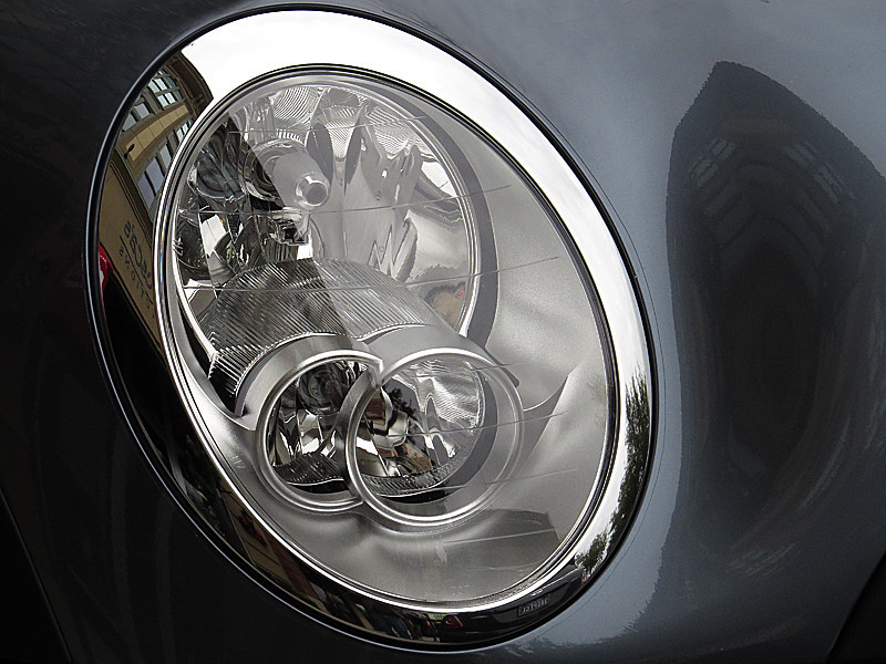 2013 12 TW Mini Cooper headlight and building reflection