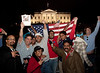 The announcement of the death of Osama Bin Laden sparked a spontaneous celebration at the north gate of the White House (in background in photo), waving flags with chants of USA USA and the singing of the National Anthem. 2:30 AM on May 2, 2011 in Washington DC.