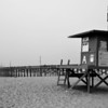 Newport Beach Pier with Lifeguard Stand black and white 2