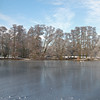18.01.13 - Ice Blue<br /> <br /> Another 3 shot photomerge panorama from Boultham Park, this time with ice on the lake and blue skies. I love the subtle reflections and dusting of snow on the frozen lake, unfortunately the sun disappeared shortly afterwards. We had a couple of inches more snow yesterday afternoon, but it is a lot milder today, just on freezing. I hope to get out for a run and photos before it starts to get slushy.<br /> <br /> Thanks for the wonderful comments on my two panos yesterday. I think I prefer the alternative daily one too :)