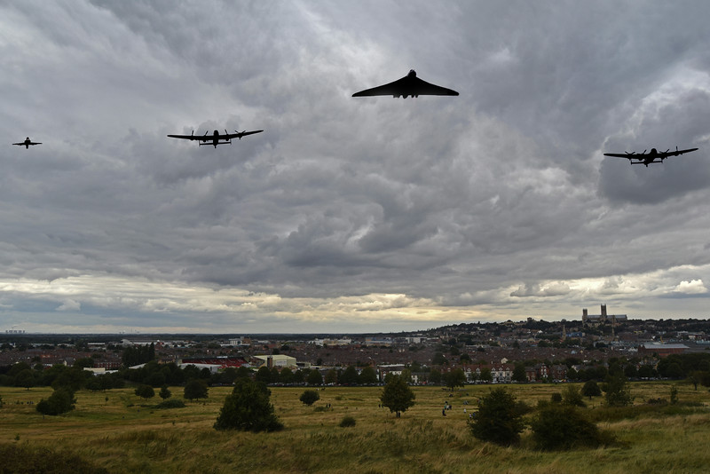 "21.08.14 - Icons<br /> <br /> Well I finally got to photograph the last two surviving Lancaster bombers together over Lincoln, and to add to the occasion the last surviving Vulcan led the formation. They were joined by a Hawk trainer on the left here. This is actually a composite, I took the wide shot of the city under that dramatic sky, and then switched to a longer lens to get closer shots of the aircraft. As it happens the formation was quite wide and this is a realistic representation of what we saw.  The Canadian Lancaster ""Vera"" is on the right as you look, and I'm hoping to photograph them together again before she returns across the Atlantic in September."