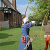 "8.8.10 - Arrows Away<br /> <br /> Back at Gainsborough Old Hall today with WAGscreen, shooting some of the final scenes of the ""Time Traveller"" short film. There was also a full scale re-enactment going on over the weekend, of which yesterday's banquet was part. So between shooting our scenes we enjoyed watching the re-enactors. This is archery practice on the lawn after Sunday morning prayers, which was compulsory in 15th century Britain. I was lucky to catch 2 arrows in flight here, and amazed at how accurate these traditional longbows could be. Twelve shots a minute, most of them bang on target, showed why this was the most effective weapon of the time.<br /> <br /> There is a gallery of the day here, and I still have many shots to add to it;       <br /> <a href=""http://www.lightanddreamsphotography.com/History/UNDER-SIEGE-1470/13254959_9th9M#962969987_bCsQT"">http://www.lightanddreamsphotography.com/History/UNDER-SIEGE-1470/13254959_9th9M#962969987_bCsQT</a>"