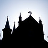 The Archabbey Church stands in a silhouette as the sun rises on April 30.