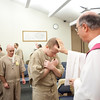 Branchville Correctional Facility offenders line up to take Communion or receive a blessing from Archabbot Justin DuVall, OSB, during a Sunday evening Mass at the facility in March.