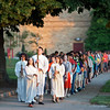"""One Bread, One Cup"" interns lead a procession of conference participants to the Archabbey Church during the reconciliation service on June 19."