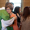 """One Bread, One Cup"" intern Gillian Karhoff Schumaker hugged conference director Fr. Godfrey Mullen, OSB, during the closing Mass of the internship on July 17."