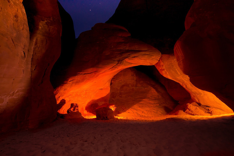 Sand Dune Arch, Arches National Park. Settings were ISO 800, f5.6 for 30 seconds, 2 stops overexposed. To light up the surroundings I had to overexpose the arch then darken just the arch in processing (Lightroom 4), leaving the soft glow on the the surrounding sand and rocks unaltered.