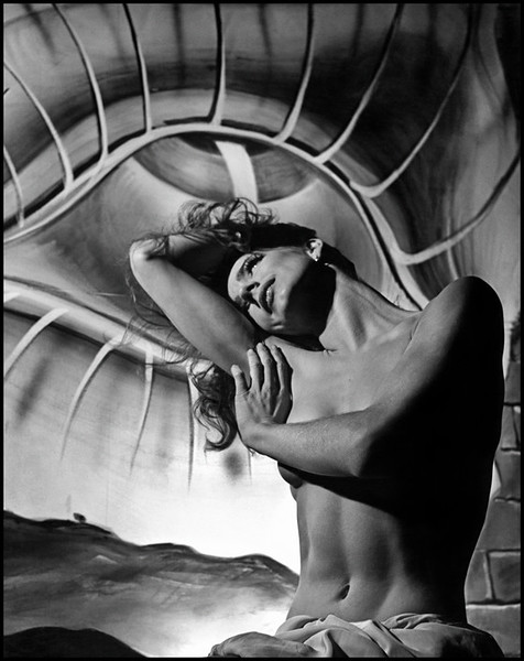 USA. 1945. Toni HOLLINGSWORTH with a Dali painting in the background.